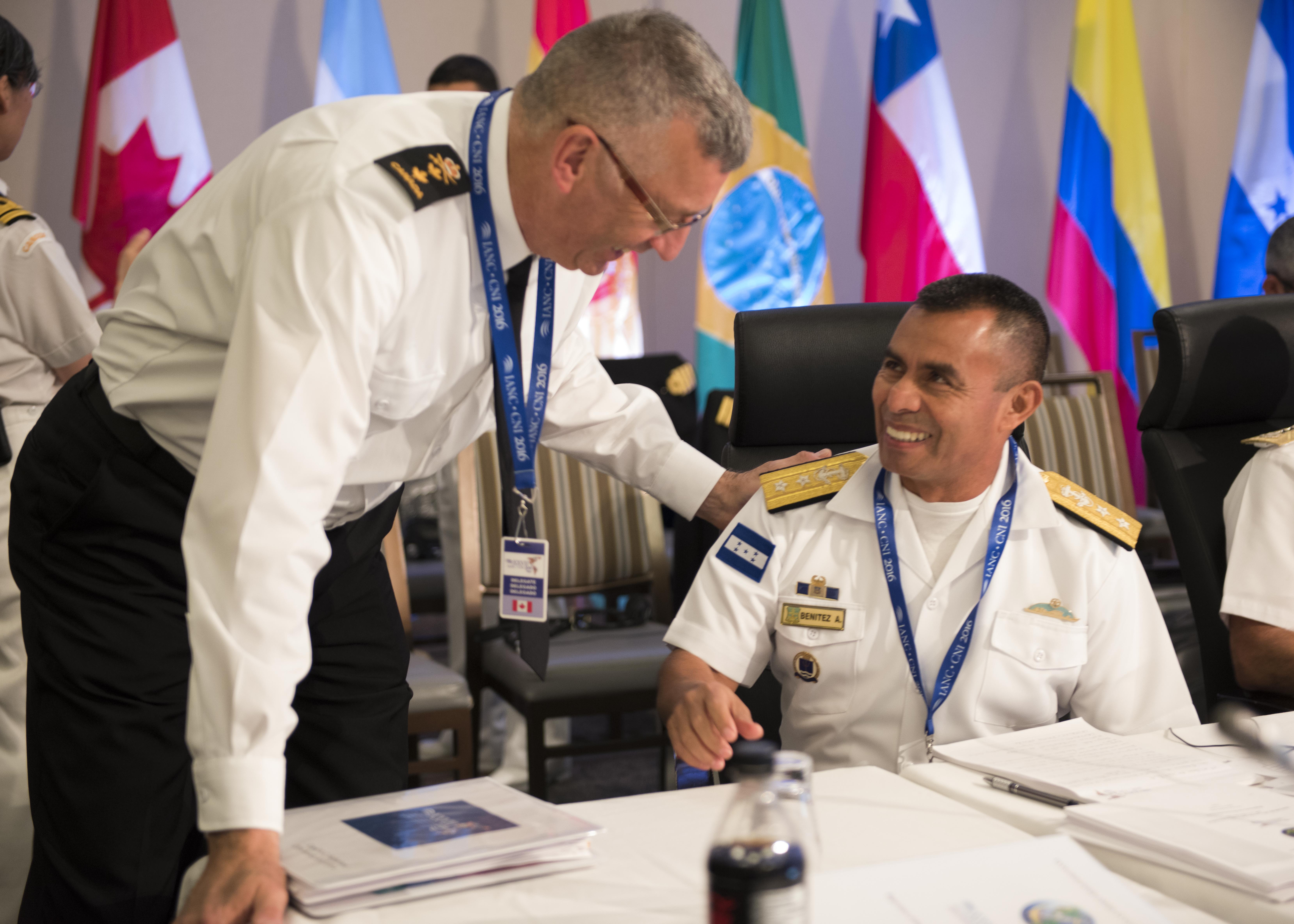 Canadian Rear-Admiral John F. Newton (left), Commander Joint Task Force Atlantic and Maritime Forces Atlantic, and Contralmirante Don Jesús Humberto Benitez (right), Commander Honduras Naval Force, have a discussion at the Inter-American Naval Conference in Halifax on June 14, 2016.