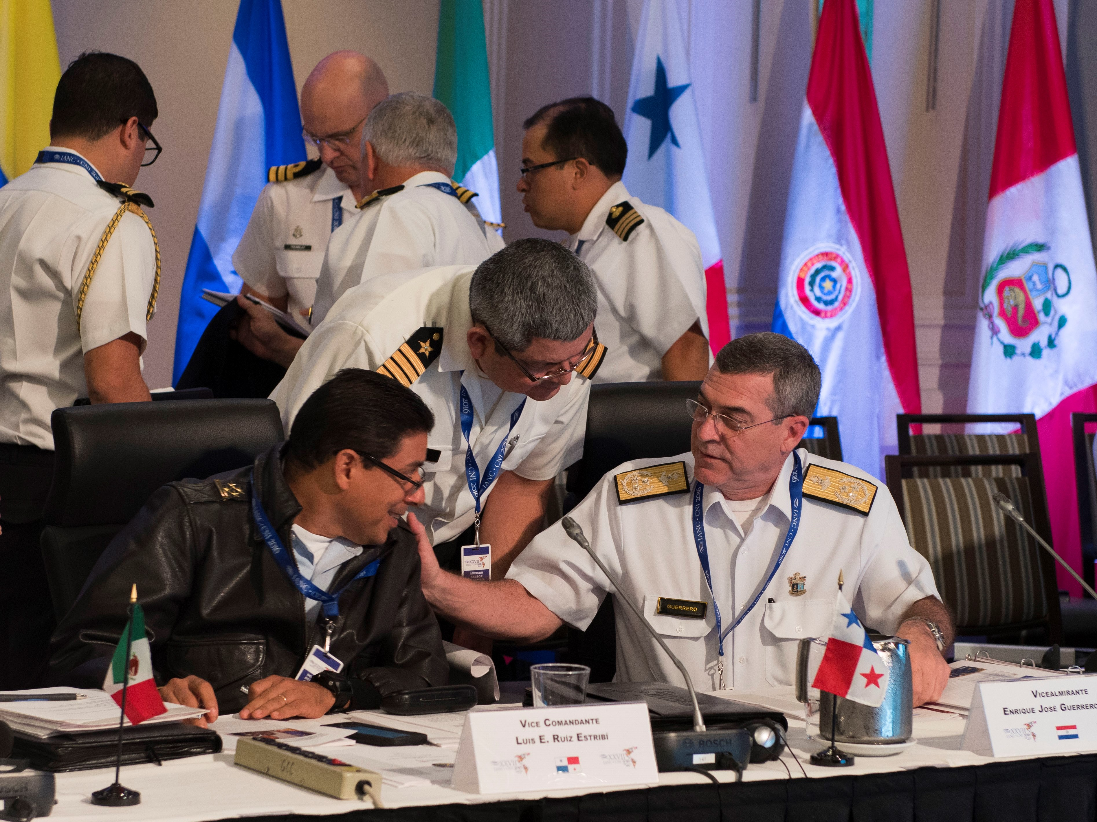Vice Commandante Luis E. Ruiz Estribi (left), Commander of the National Aeronaval Service of Panama, and Vicealmirante Enrique Jose Guerrero Cali (right), Jefe de estado mayor de la armada paraguaya, have a discussion at the Inter-American Naval Conference in Halifax on June 14, 2016.