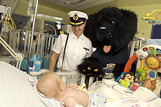 The Navy's Mascot and Commander Nagel, docor onboard KMS KARLSHRUE, visited the childrens at the C.H.U.L of Québec  Photo: Cpl Isabelle Provost
