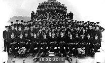 The crew of the first HMCS Iroquois, commissioned in 1942, crowd the deck of the ship.