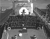 The commissioning crew of the second HMCS Iroquois, commissioned in 1972, pose on the deck of the ship, unaware that nearly 11,500 sailors will follow in their footsteps and that the ship will sail approximately 860,000 nautical miles throughout its time in service, the equivalent of circumnavigating the globe forty times.