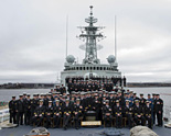 The last crew of HMCS Iroquois sit upon the foc'sle for a final photo before the ship is paid off on 1 May. The crew will move on to other departments of the Royal Canadian Navy to enable fleet operations and to welcome the Navy's future fleet.