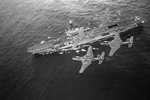 The sea-based fighter air defence of the fleet, as provided by these Banshees flying over Bonaventure, would prove too costly to maintain, and both aircraft and carrier would be scrapped by the end of the decade.