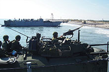 A LAV-III crew of the Royal 22e Regiment makes an amphibious landing during an exercise proving the Standing Contingency Force concept of operations, November 2006.