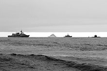 Left to right: HMC Ships Fredericton, Summerside, and Corner Brook sail in formation past an iceberg during Operation Nanook, August 2007.