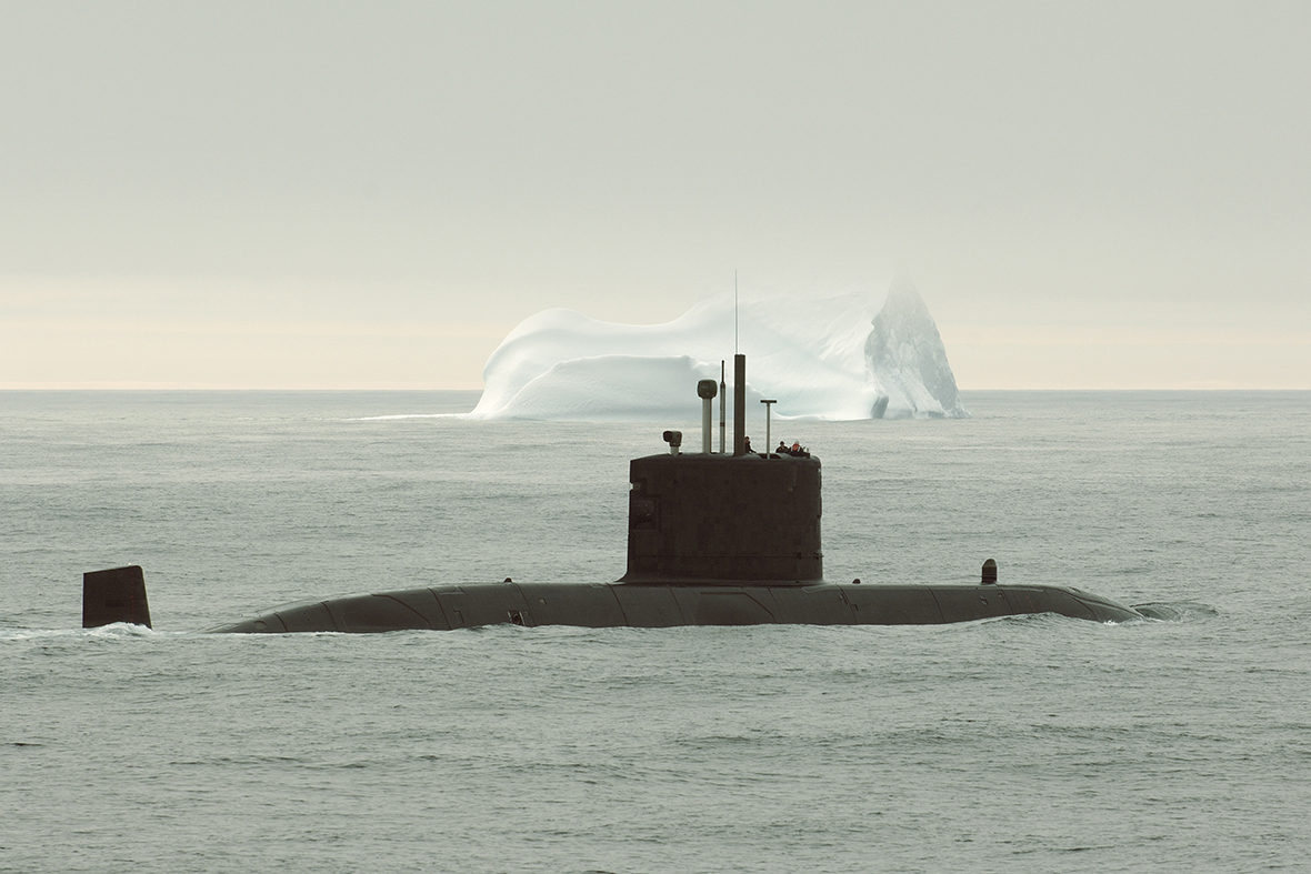 A submarine surfacing the water.