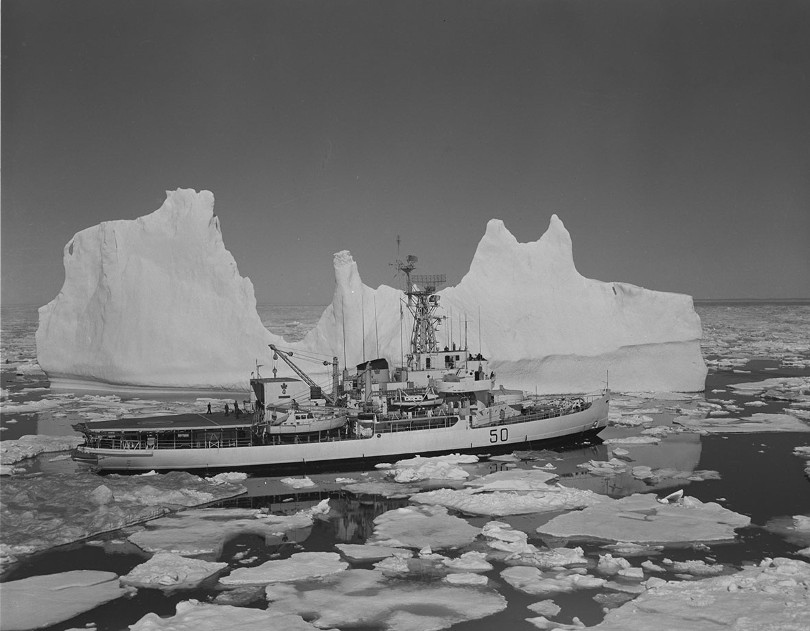 A ship travelling through icy waters.