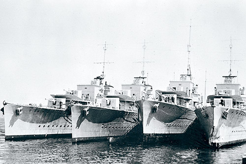 At the beginning of the Second World War the RCN comprised of six destroyers and seven smaller vessels. Seen here tied up alongside in HMC Dockyard Halifax are four of Canada's six destroyers - HMCS Assiniboine (I-18), HMCS Ottawa (H-60), HMCS Restigouche (H00), HMCS St-Laurent (H83).