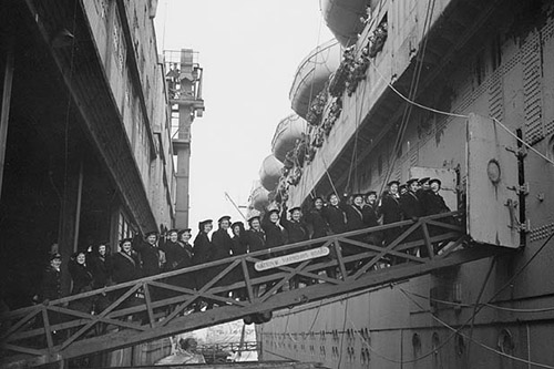 Personnel of the Women`s Royal Canadian Naval Service (WRCNS) embark on a troop ship in Halifax NS destined for the United Kingdom to serve overseas.