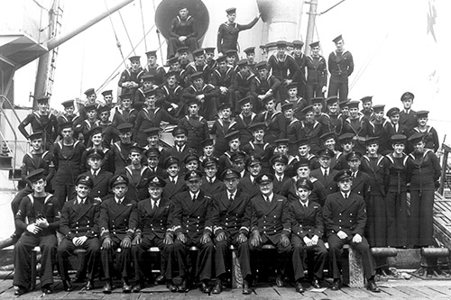A crew of an unidentified escort poses for a ship's company photo while alongside in St. John's.