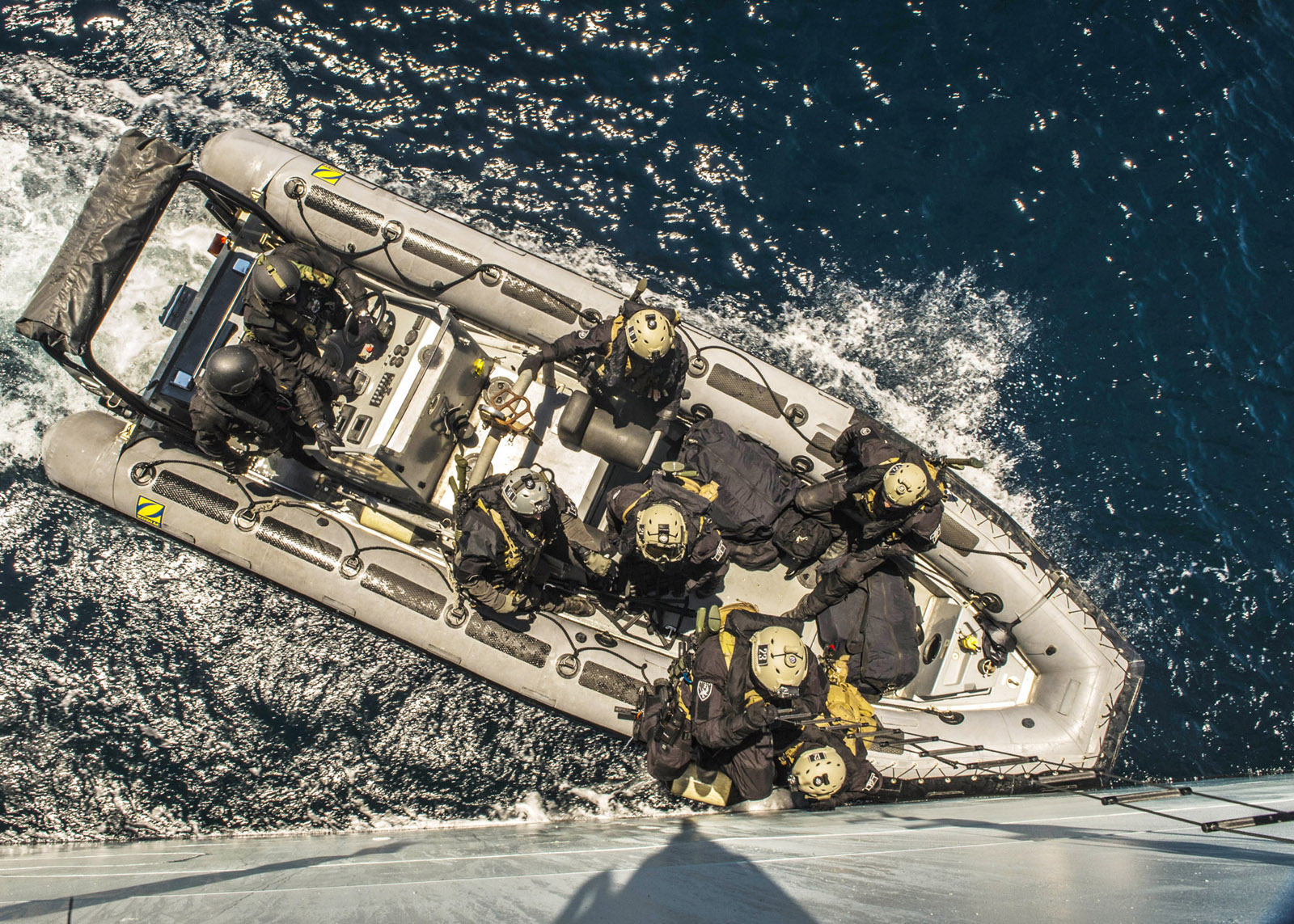 HMCS Fredericton's enhanced naval boarding arrives in its rigid-hulled inflatable boat to climb aboard a suspect vessel during a multinational exercise in the Mediterranean Sea.