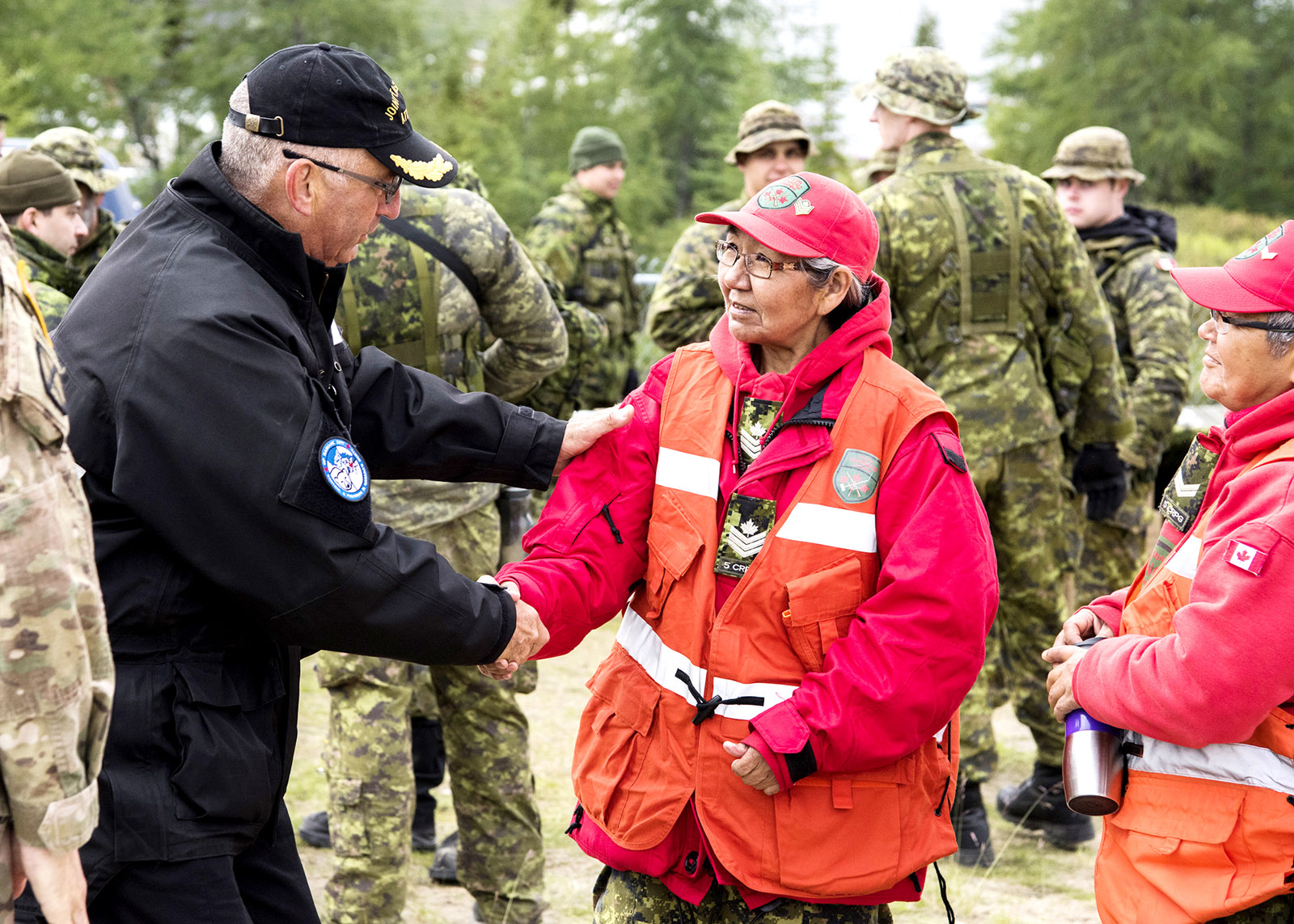 Rear-Admiral John Newton, former Commander of Maritime Forces Atlantic, talks to members of the Canadian Rangers in the community of Nain, Labrador.