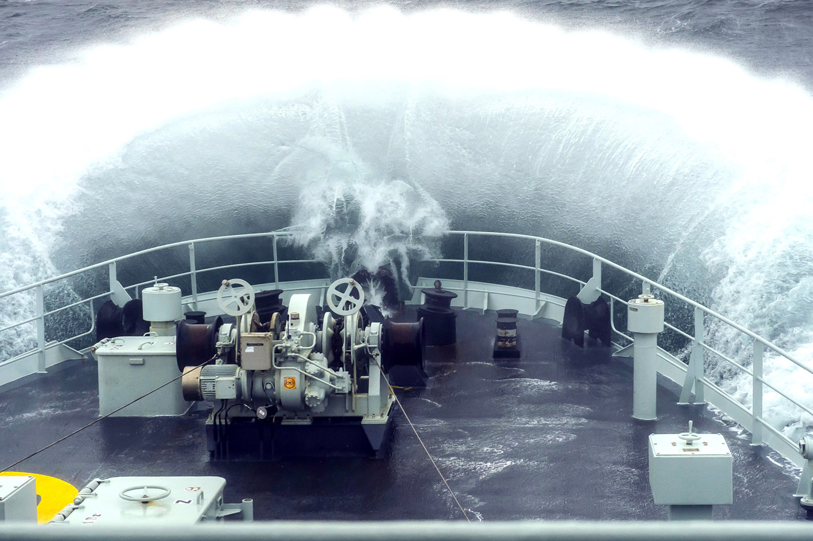 Water crashes over the fo'c'sle of HMCS Edmonton.