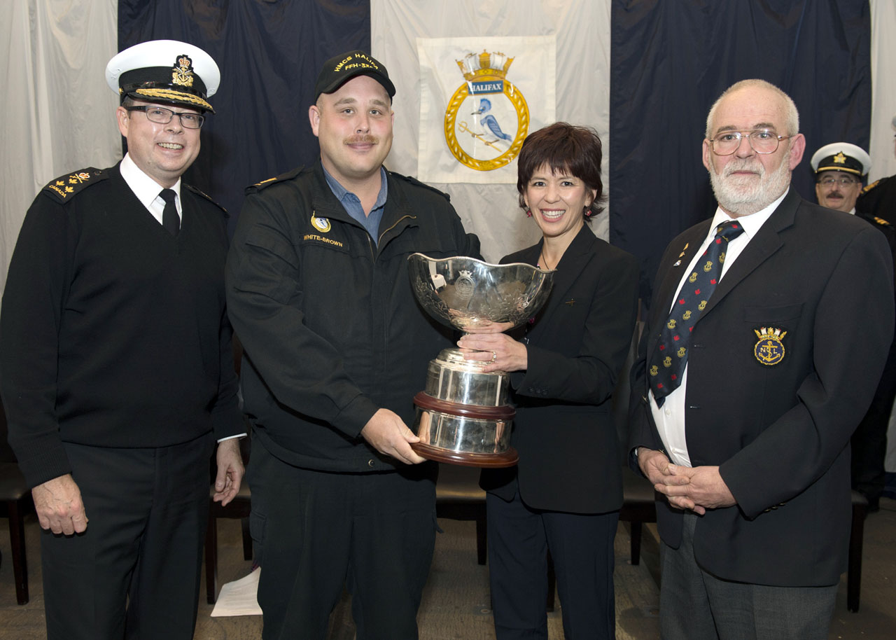 Vice-Admiral Mark Norman, left, Commander Royal Canadian Navy; Rosemary Chapdelaine, President Lockheed Martin Canada; and Lieutenant (Navy) Earl Corn, right, of the Navy League of Canada; present Master Seaman William White-Brown with the 2013 Royal Canadian Navy Centennial Award.