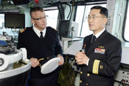 Rear-Admiral Kim Duk-ki of the Republic of Korea Navy (ROKN) talks with Commander Paul Francoeur on the bridge of HMCS Regina. The first-ever staff talks held between the Royal Canadian Navy and the ROKN were held in November, part of the Canadian Armed Forces' global engagement strategy to strengthen relations with key partners in the Asia-Pacific region. The two parties examined a range of themes, shared their perspectives on common strategic issues, and examined ways to increase bilateral exchange and training opportunities. As part of the two-day program, the ROKN delegation toured Regina, the Fleet Maintenance Facility and Venture, the Naval Officer Training Centre.