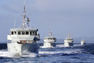 Patrol craft training boats sail in formation during an exercise in the Strait of Juan de Fuca near Victoria February 14. Eight of these Orca-class steel-hulled patrol boats were constructed by Victoria Shipyards and delivered between 2006 and 2008 to replace the 50-year old, wooden-hulled yard auxiliary general training vessels. Based at CFB Esquimalt, B.C., these vessels are primarily used as training platforms.