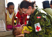 Lieutenant (Navy) Melanie Espina, doctor for the 1st Canadian Field Hospital and member of the Canadian Armed Forces Disaster Assistance Response Team (DART), examines a baby during Operation Renaissance, in Sara, Philippines on November 21 following Typhoon Haiyan. One of the strongest typhoons ever recorded, Typhoon Haiyan set off landslides, knocked out power in several provinces and cut off communications in the country's central region of island provinces, affecting an estimated 11.3 million people in nine different regions across the Philippines. DART is a multi-disciplinary, self-sufficient and flexible military capability which can deploy quickly to anywhere in the world.