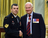 Petty Officer 2nd Class Jason Sparkes, left, was presented with the Star of Courage by His Excellency the Right Honourable David Johnston, Governor General of Canada, during a ceremony at Rideau Hall in December.  PO2 Sparkes, a volunteer firefighter, was honoured for his bravery following a harrowing rescue in 2010 when he and other first responders were called to Peggy's Cove after a wave washed a man off the rocks. During the search for the victim, an RCMP constable was also swept into the ocean. Thanks to the efforts of PO2 Sparkes and others, the constable was rescued from the water. Tragically, the original victim could not be saved.