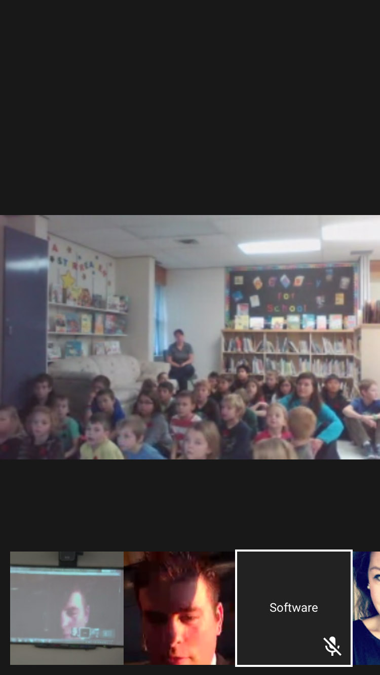 Students from Edenwold School in Saskatchewan ask questions to Sub-Lieutenant Jamie Tobin onboard HMCS Winnipeg during a virtual town hall as part of the school's Remembrance Day activities on November 6, 2015. Photos taken from a cellphone screen shot.