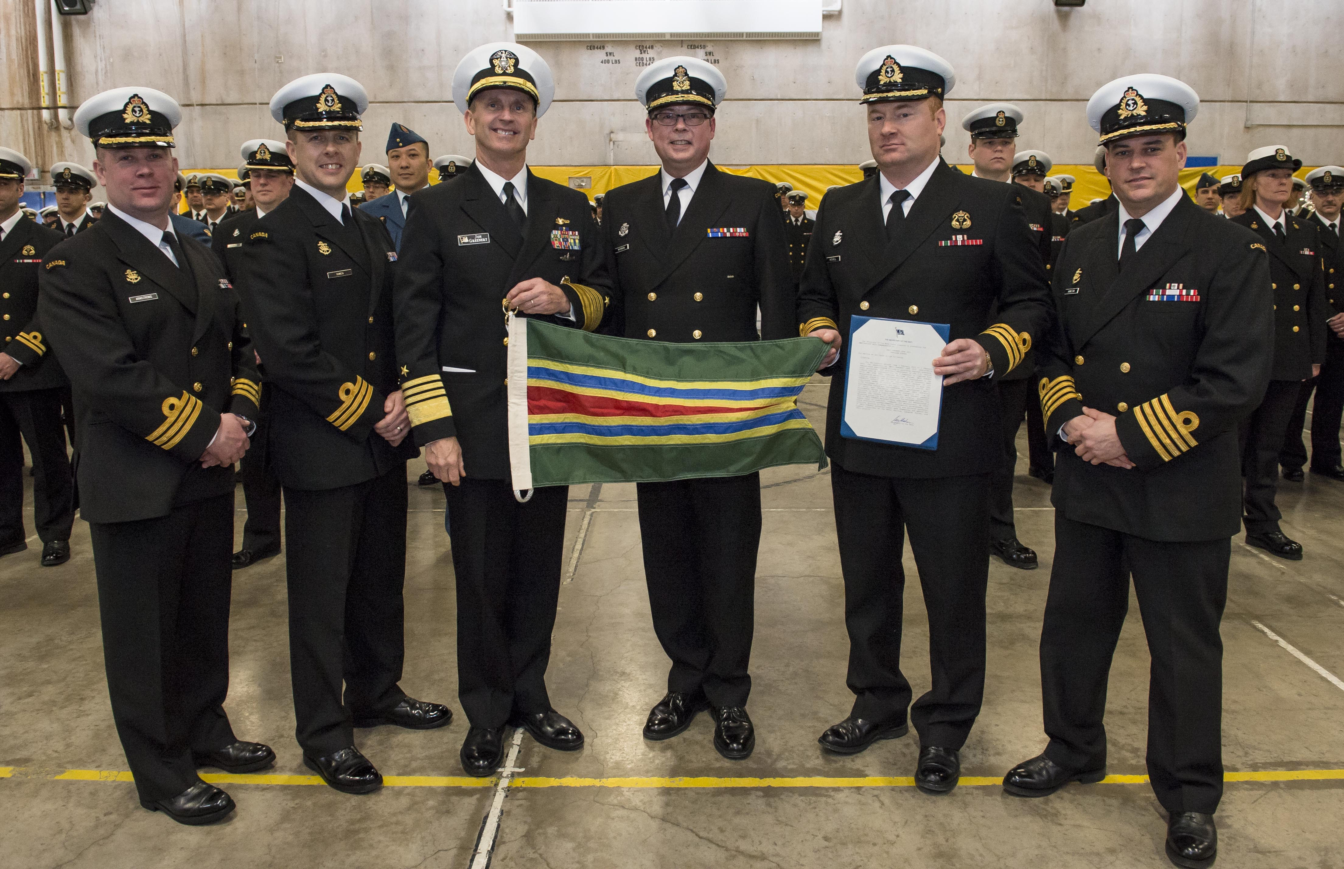 The United States Navy awards Her Majesty's Canadian Ship (HMCS) TORONTO the Meritorious Unit Commendation