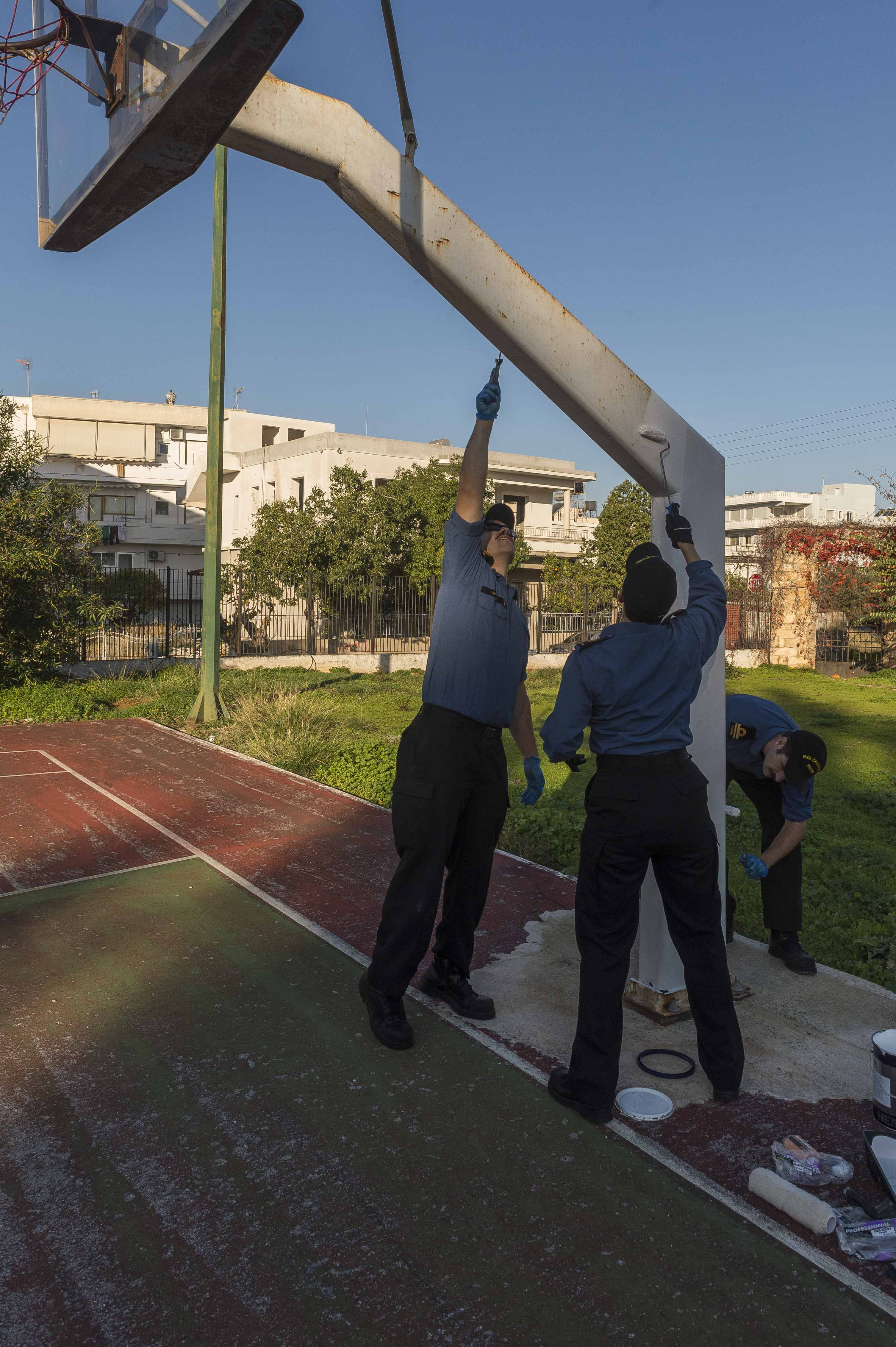 Crew members from Her Majesty's Canadian Ship (HMCS) Charlottetown spread some holiday cheer by helping to clean the grounds of an orphanage in Chania, Crete during OP REASSURANCE, December 10, 2016.