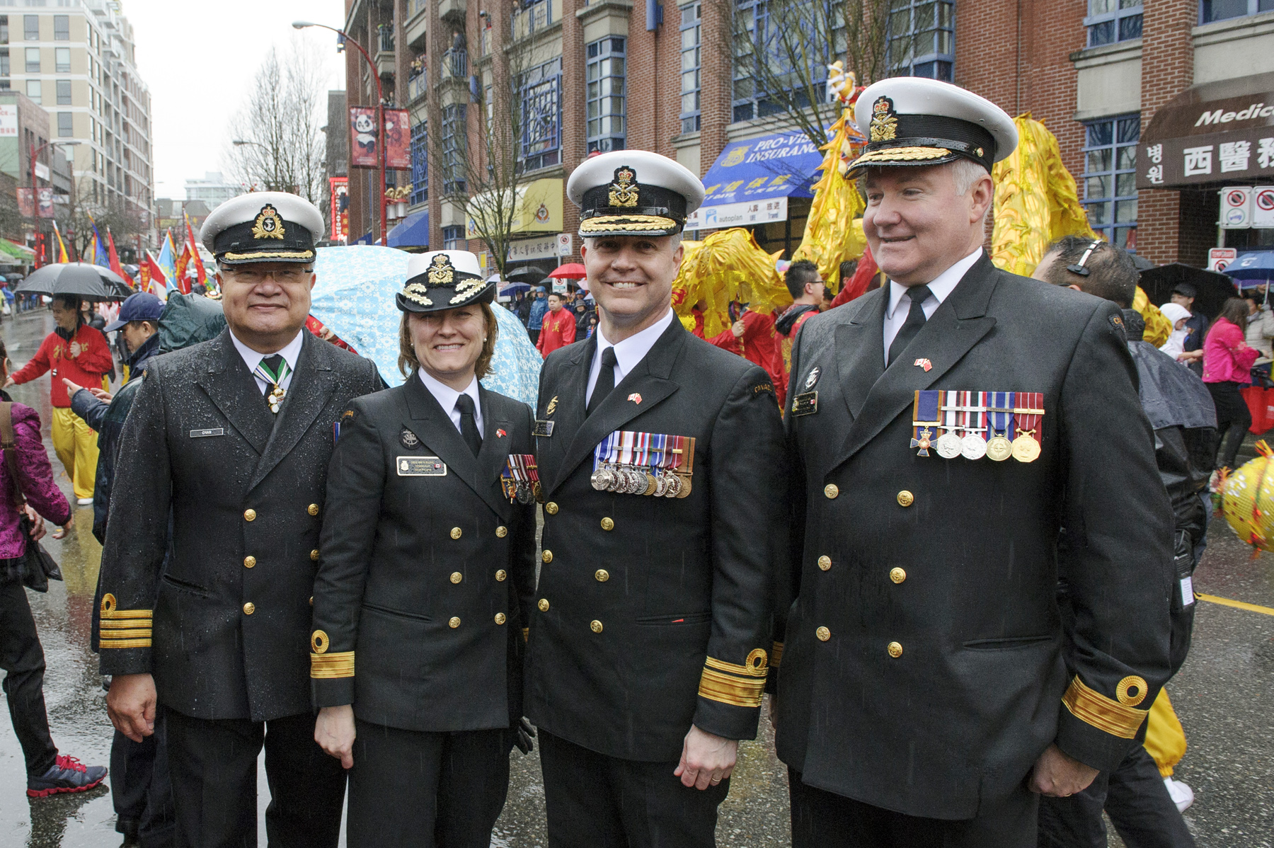 From left: Honorary Captain (Navy) Tung Chan, Commodore Marta Mulkins, Rear-Admiral Art McDonald and Commodore Jeffrey Zwick pose together at the Chinese New Year parade in Vancouver.