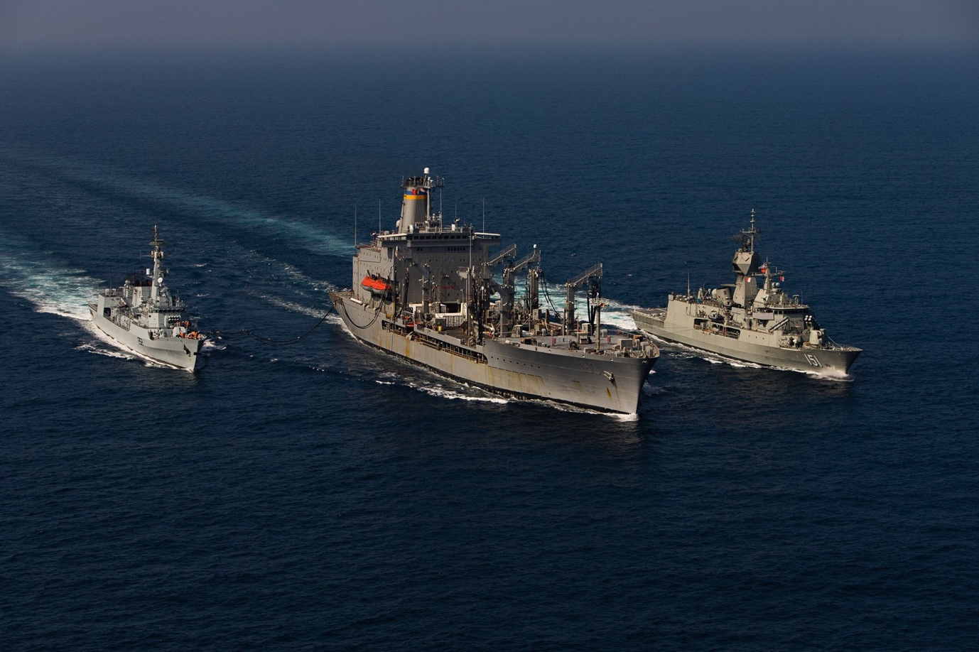 Ships conduct replenishment-at-sea operations