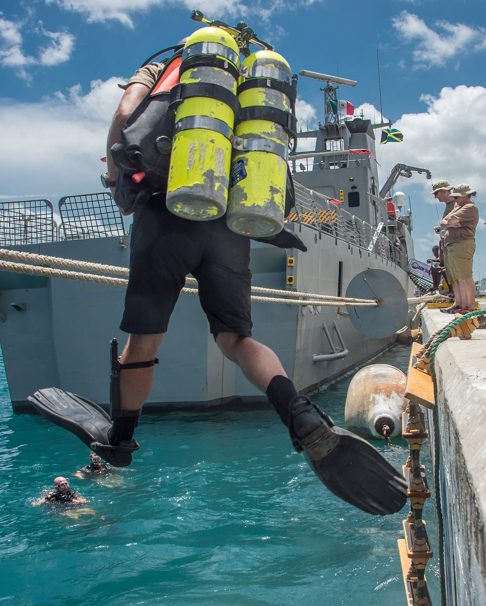 A Canadian Armed Forces diver jumps from a jetty during Exercise TRADEWINDS 16 in Montego Bay, Jamaica on June 20, 2016.