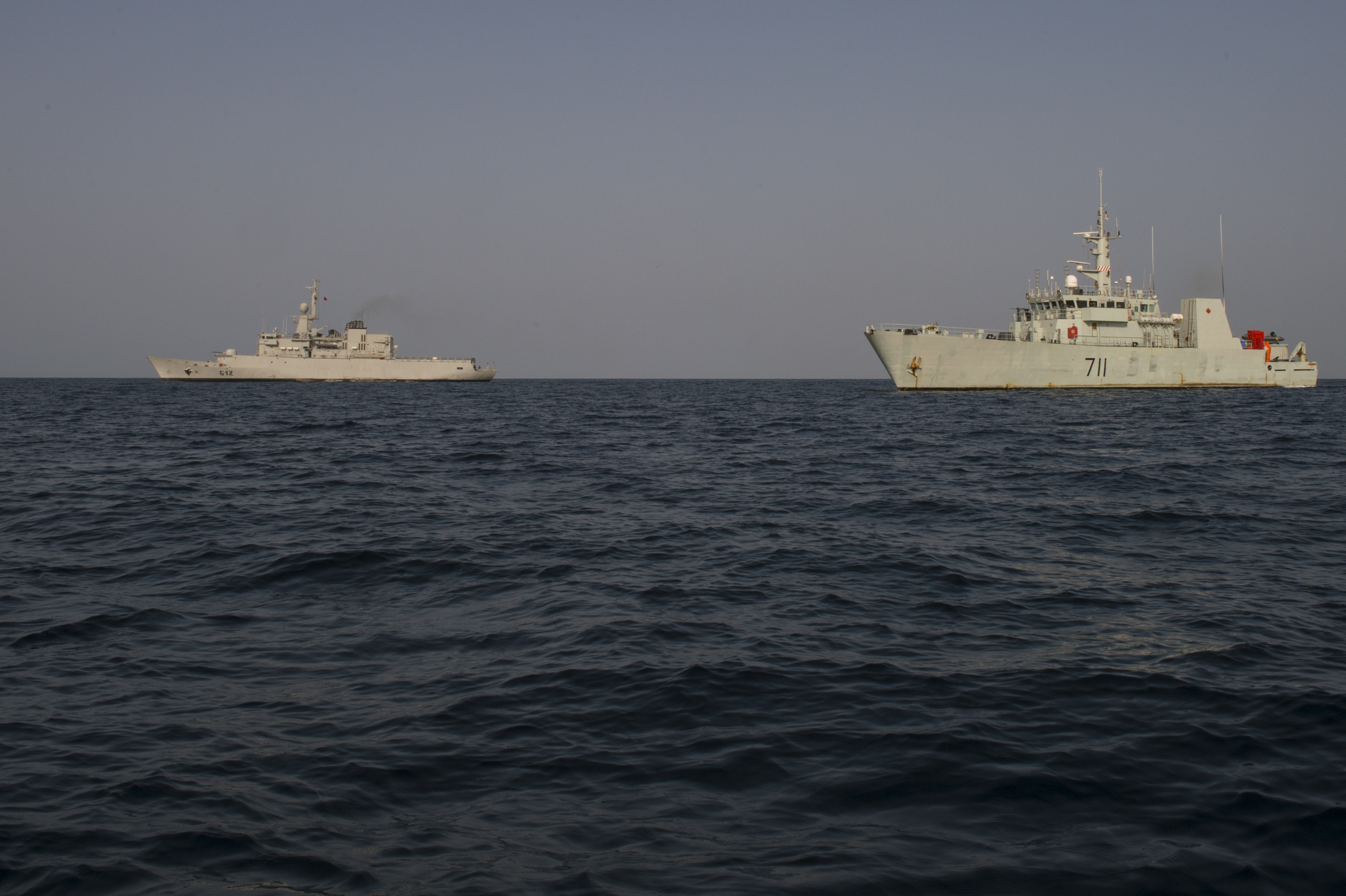 Royal Moroccan Navy Frigate, Hassan II, and HMCS Summerside sail side by side, off the coast of Sierra Leone, during Neptune Trident 17-01, on March 26, 2017.