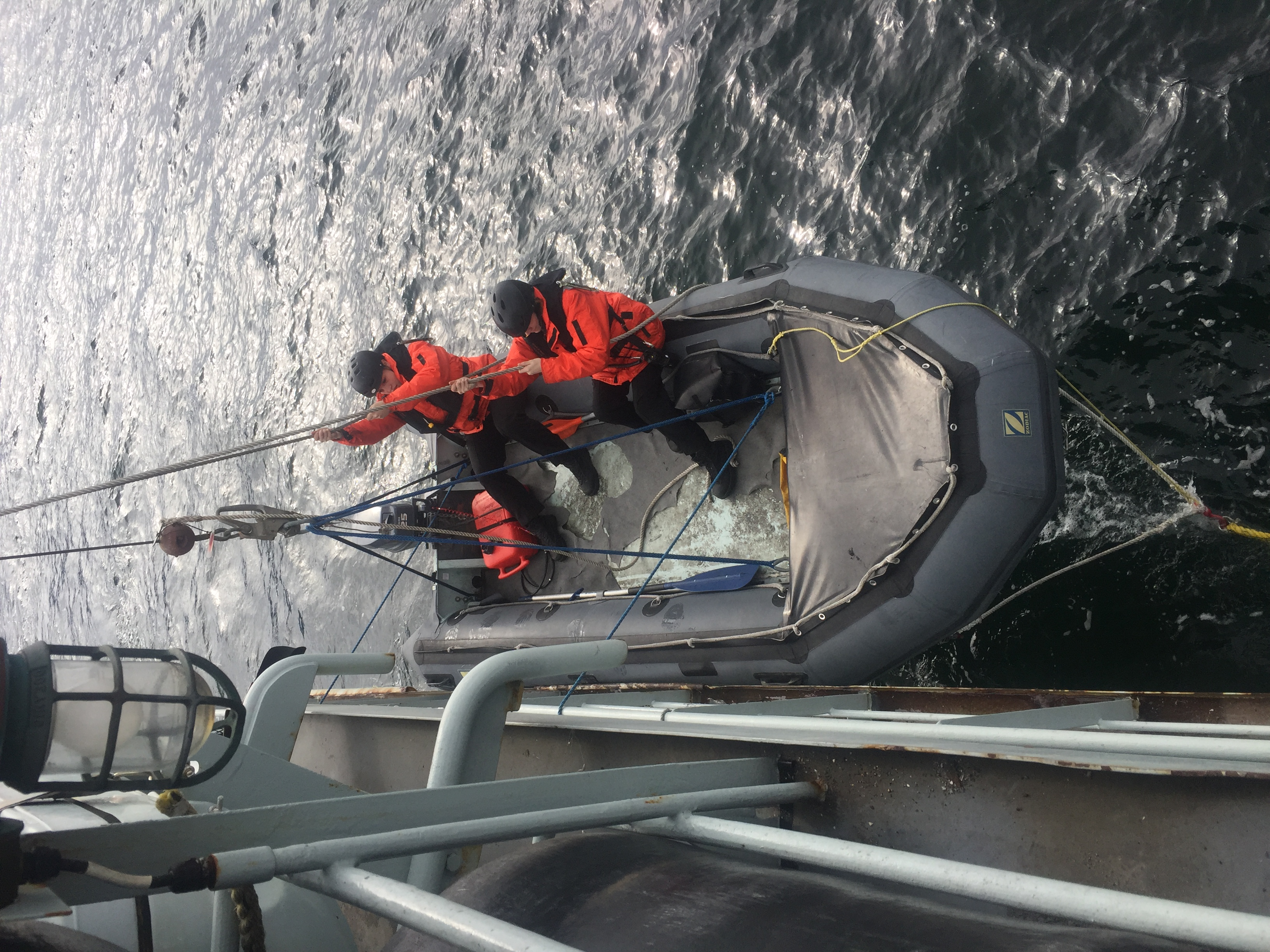 Able Seaman Cassandra Littlepine and Ordinary Seaman Roxanne Cassista participate in a man overboard drill during a training sail through the Gulf Islands of British Columbia.
