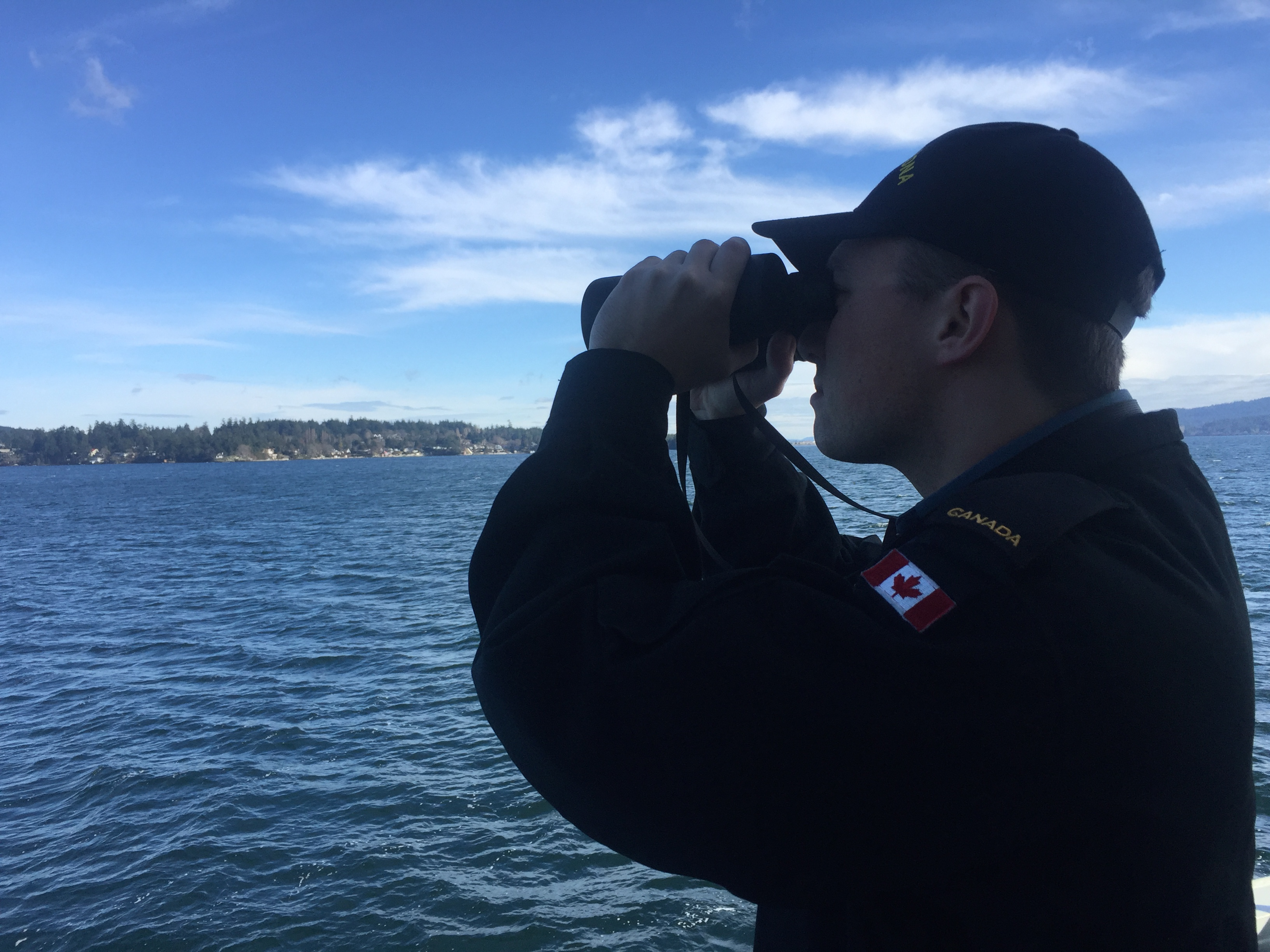 Ordinary Seaman Michael Colangelo-Lauzon is on lookout aboard Orca-class vessel Wolf 59 during a training sail through the Gulf Islands of British Columbia.