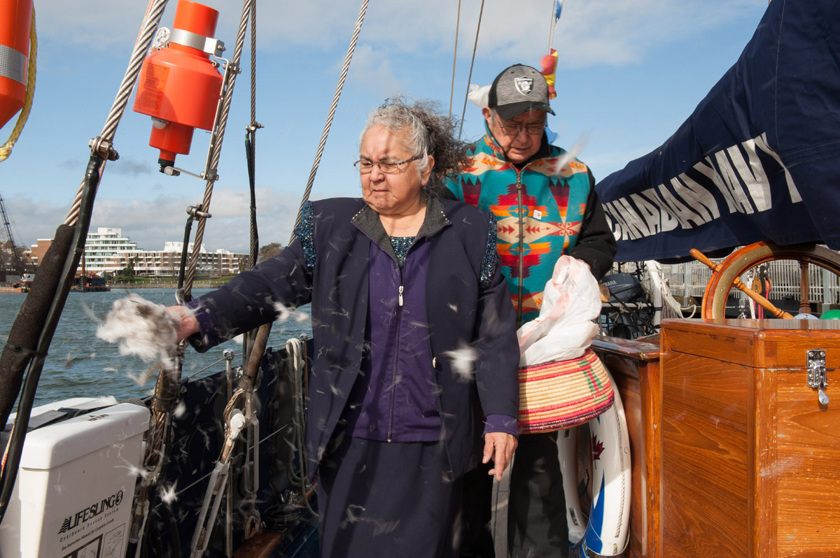 Elders Maryanne Thomas and Elmer George of the Esquimalt and Songhees Nations offer a blessing and song ahead of HMCS Oriole's journey.
