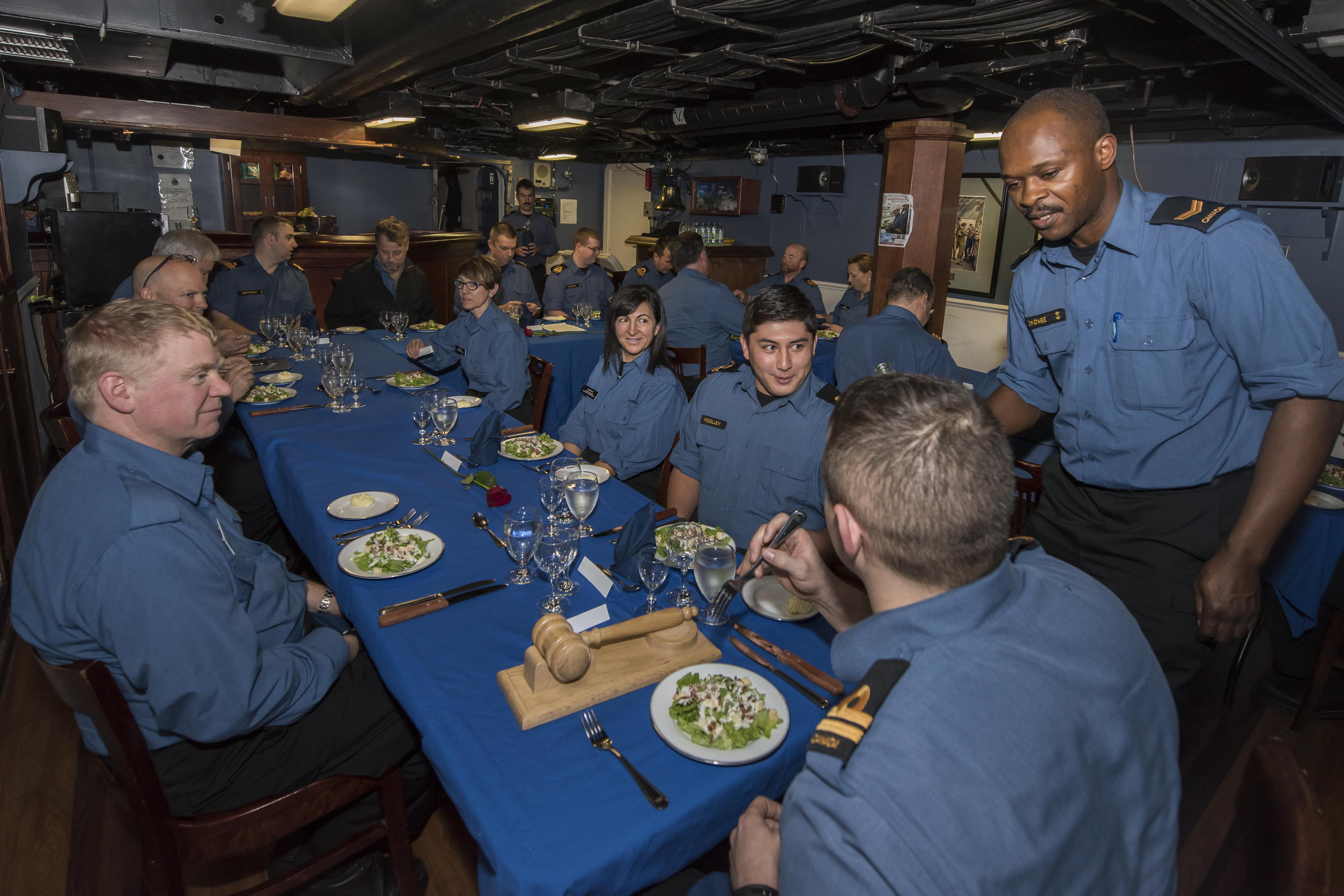 All of the guests and officers aboard the ship gathered on the evening of December 1 for a formal mess dinner in the wardroom.
