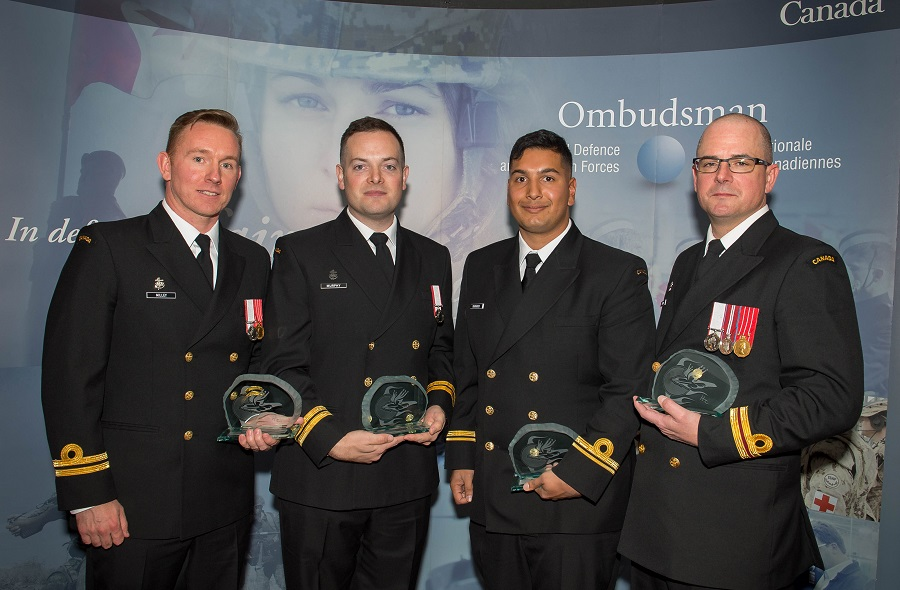 The officers from HMCS Nanaimo who were awarded the Liz Hoffman Memorial Commendation