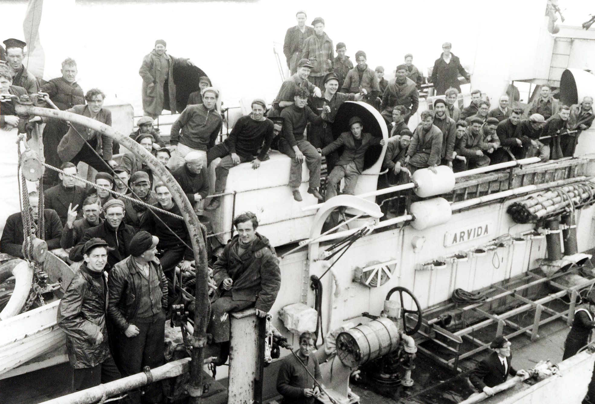 slide - Seamen from torpedoed ship aboard HMCS Arvida, St. John's, NL June 1945.