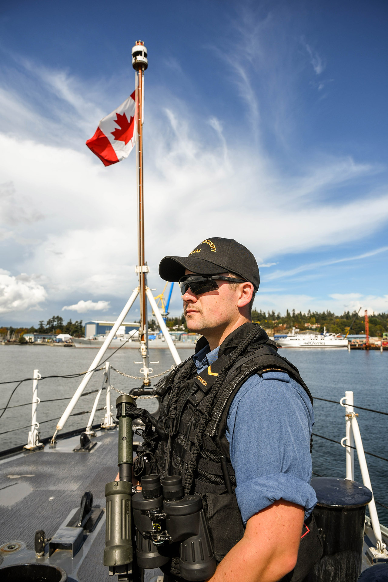 AB Darcey Tieincy on watch as upper deck sentry aboard HMCS Vancouver during the sea training validation phase prior to deployment.