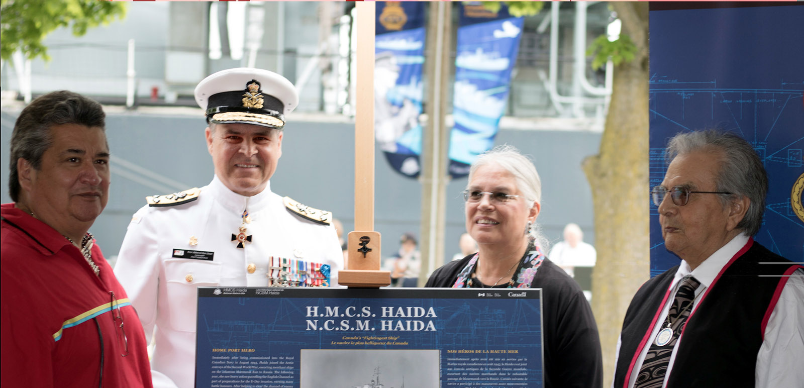 Vice-Admiral Ron Lloyd, Commander RCN, stands together with Chief R. Stacey Laforme, left, Chief Ava Hill, second from right, and Chief Frank Collison during a special ceremony that saw HMCS Haida commissioned as flagship of the RCN.