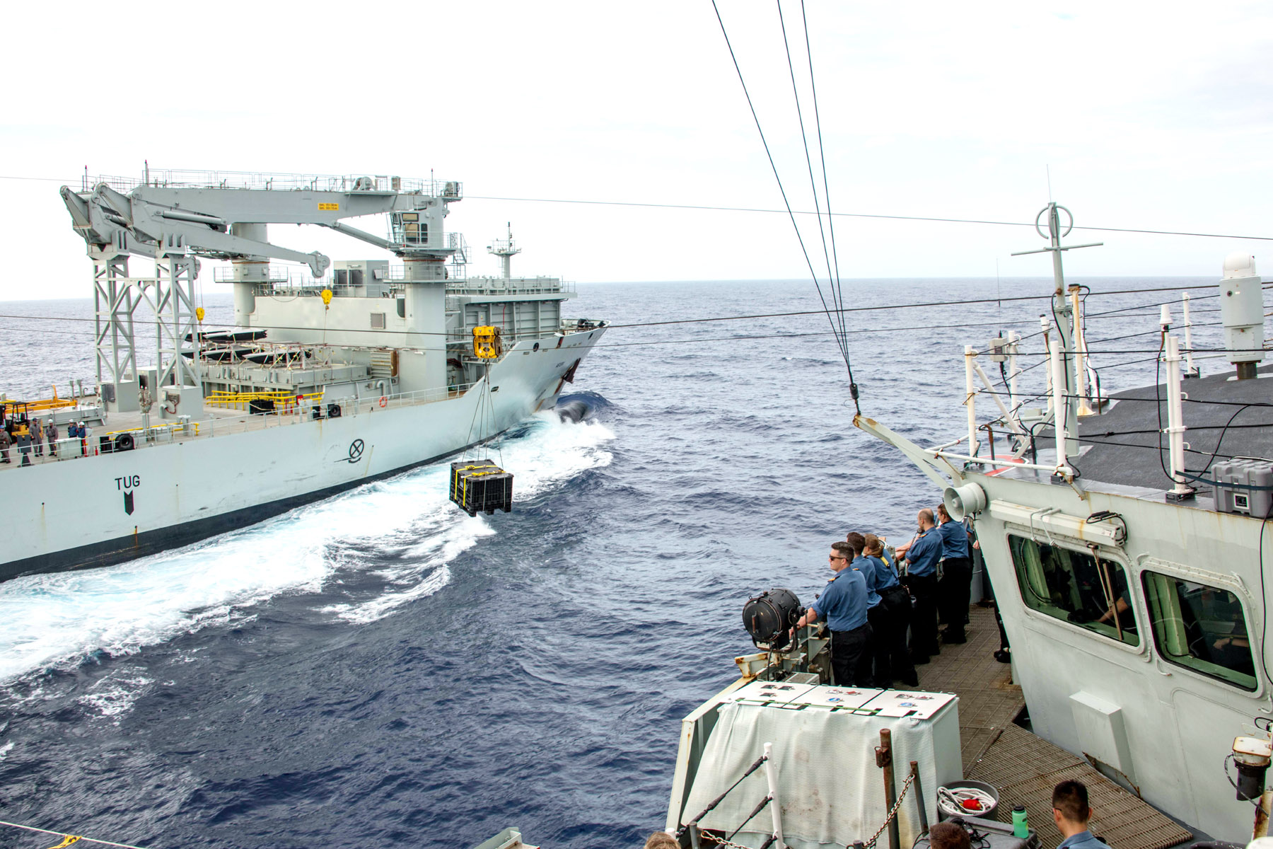 HMCS Vancouver is resupplied at sea from MV Asterix during RIMPAC.