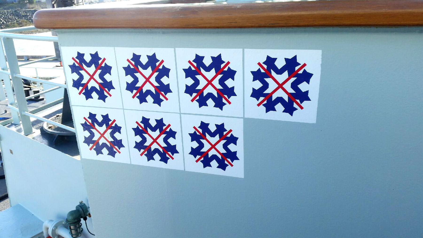 The seven snowflakes earned by HMCS Edmonton are displayed on the ship's bridge wing.