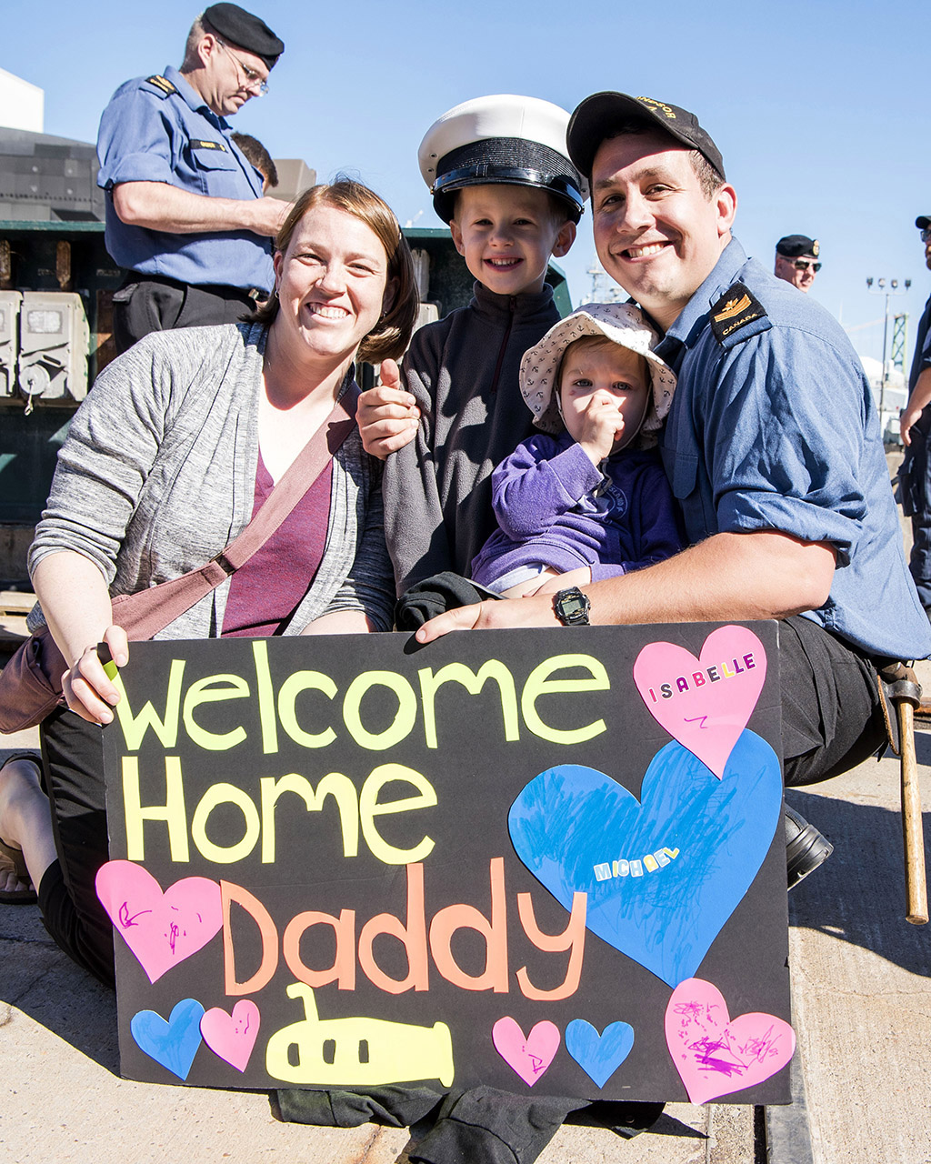A happy homecoming for the Larkin family. From left, Jennifer, Michael, Isabelle and Petty Officer 2nd Class Matthew Larkin on the jetty after HMCS Windsor arrives in Halifax.