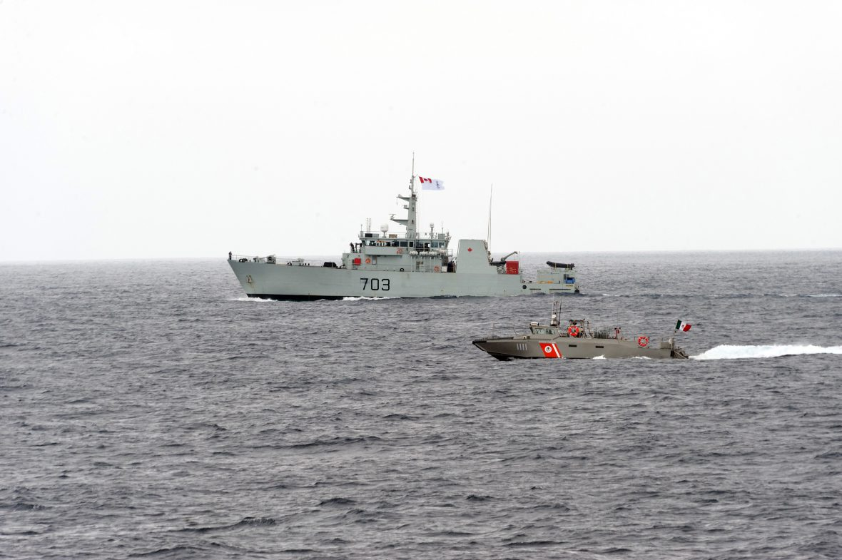 HMCS Edmonton sails in formation with AMR Avior during a cooperative deployment off the pacific coast of Mexico during Operation CARIBBE on 23 October, 2018.