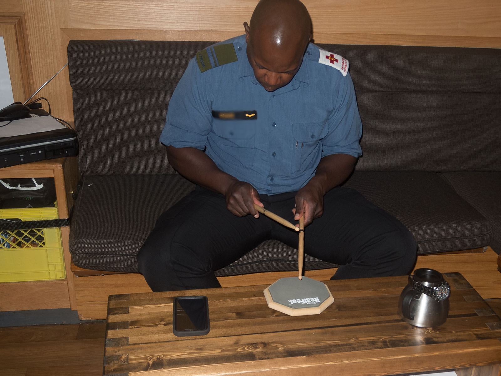 The Physician's Assistant in HMCS NANAIMO works on learning to drum between patients on October 29, 2018 during OPERATION CARIBBE.