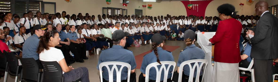 Crew members from Her Majesty's Canadian Ships (HMCS) Shawinigan and Kingston are welcomed to Le Lycée Moderne de Jeunes Filles in Abidjan, Côte d'Ivoire during Operation PROJECTION West Africa on February 23, 2019.