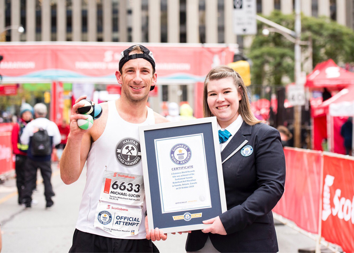 Lieutenant (Navy) Michael-Lucien Bergeron receives a certificate after setting a 'joggling' Guinness World Record with his 1:17:9 hour half-marathon while juggling three balls time at the Scotiabank Toronto Waterfront Marathon in Toronto, Ontario, on October 21, 2018. Photo courtesy of Canada Running Series