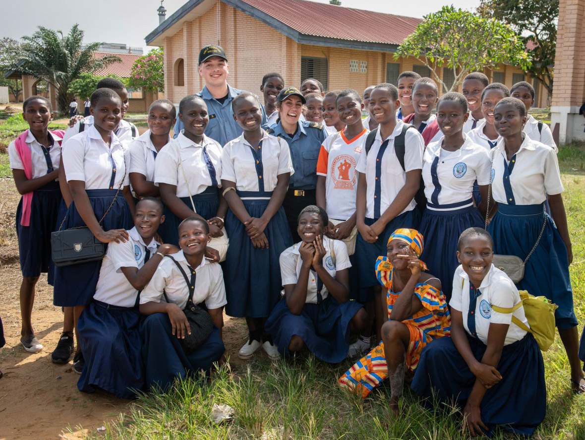 Lycée Moderne de Jeunes Filles student Prisca Coulibaly (center) is joined by Leading Seaman Josephine Simson, Able Seaman Guillaume Levesque, and her peers during a community relations visit in Abidjan, Côte d'Ivoire during Operation PROJECTION West Africa on February 23, 2019.