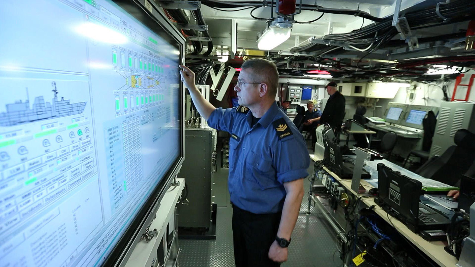 A Royal Canadian Navy Sailor monitors the ship's systems in the machinery control room.