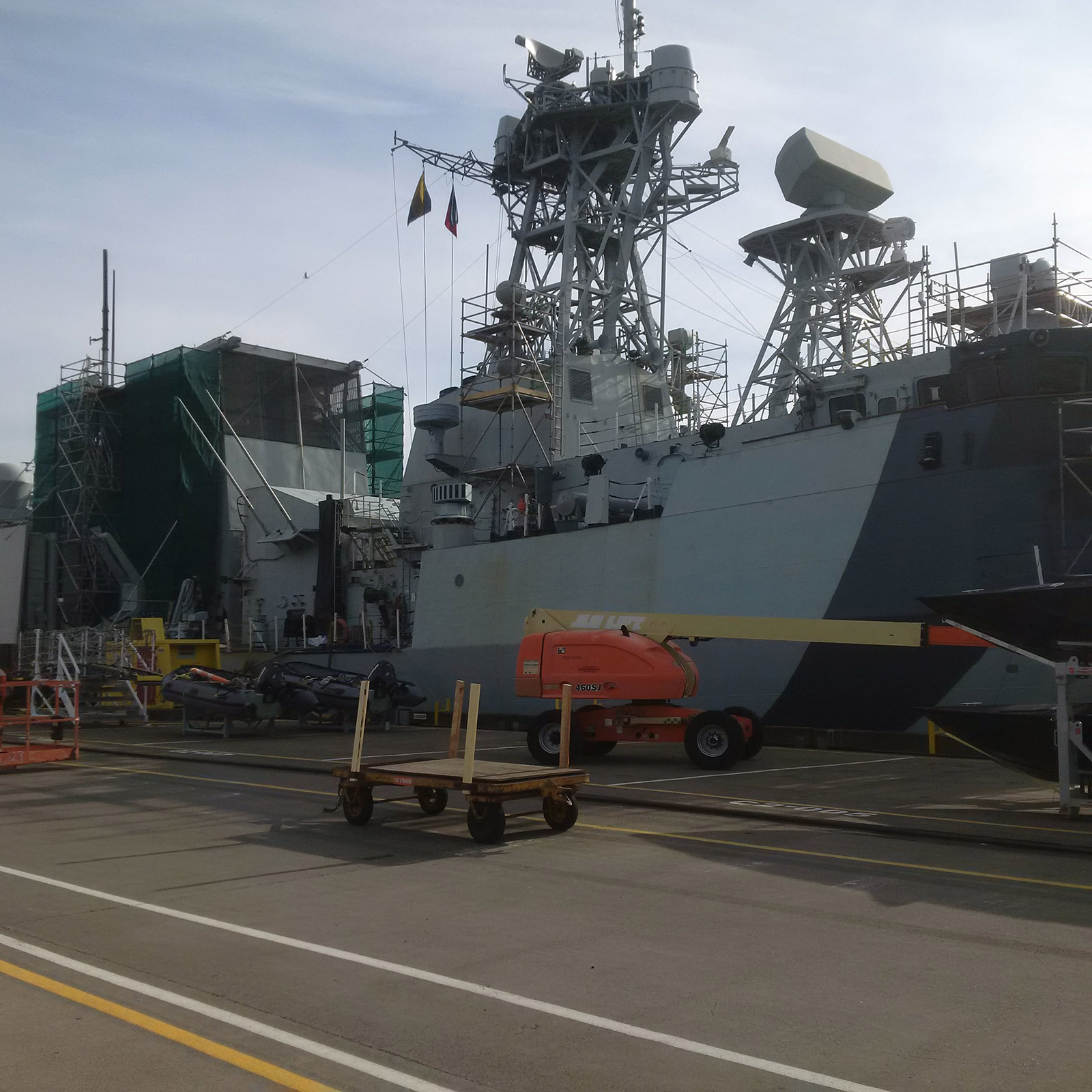 Work on HMCS Regina, which will be painted in a white and blue geometric scheme, is currently underway at CFB Esquimalt, and is expected to be complete by mid-October.