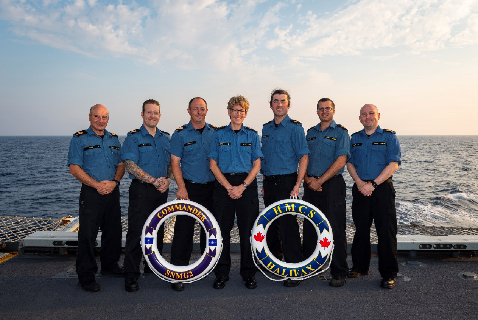 Commodore Josée Kurtz and six sailors who served with her in HMCS Halifax both during her 2009-2010 command and during Operation REASSURANCE in 2019. From left: Master Seaman Moniz, Petty Officer Second Class Gray, Petty Officer Second Class Harnish, Commodore Kurtz, Petty Officer First Class Stevens, Master Seaman Miller, and Petty Officer Second Class Maclean.