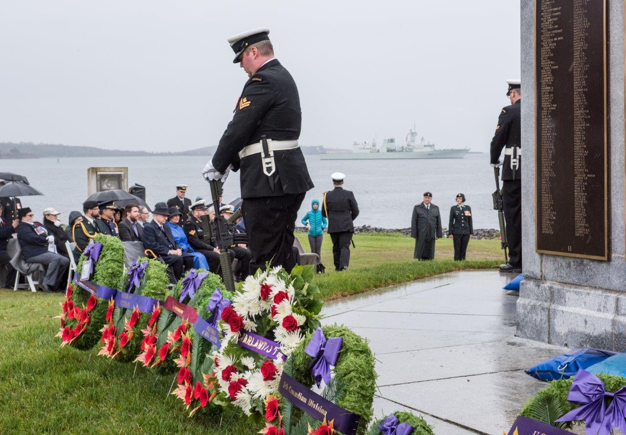 HMCS Fredericton stands offshore from Point Pleasant Park during the D-Day ceremony.