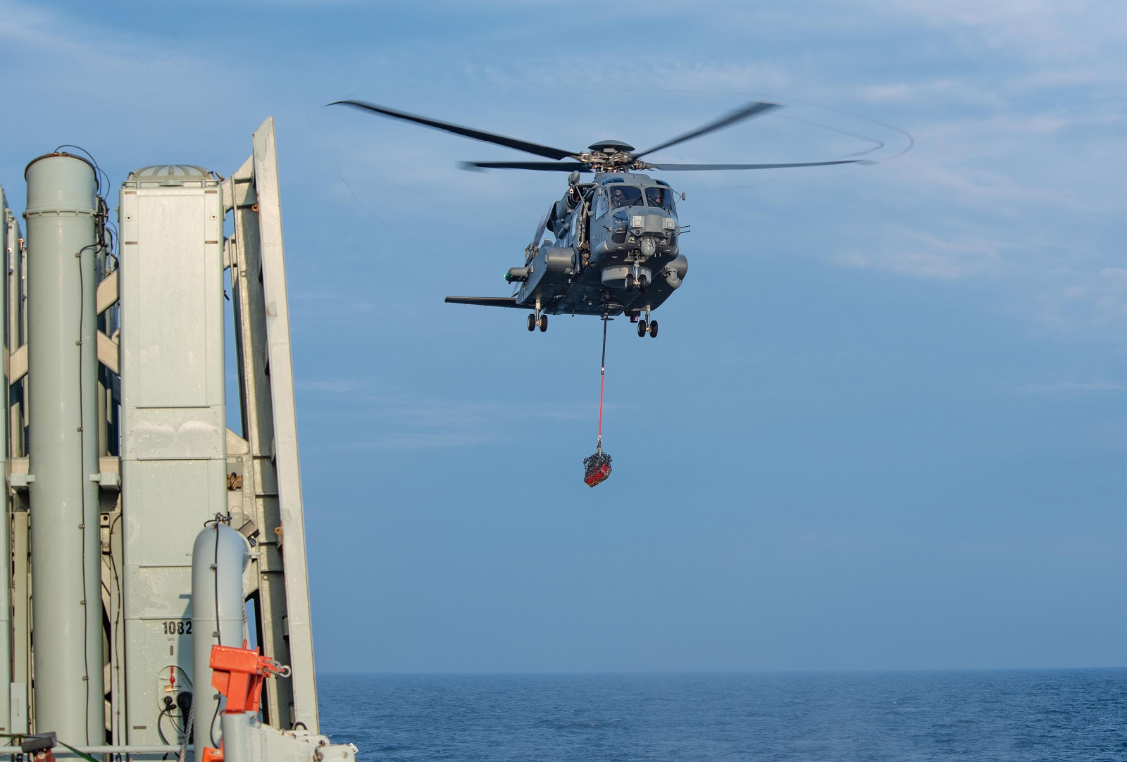 The CH-148 Cyclone, RAPTOR, embarked on HMCS Toronto, carries out vertical replenishment training in the Black Sea during Exercise SEA SHIELD on April 9, 2019.